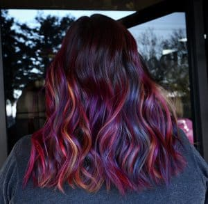 Multicolor and red highlights on dark hair