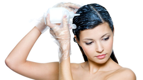 beautiful woman dyeing hair